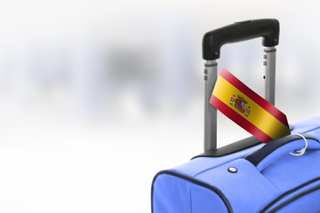 Destination Spain. Blue suitcase with flag.