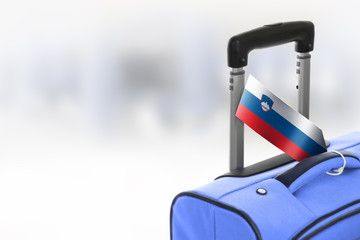 Destination Slovenia. Blue suitcase with flag.