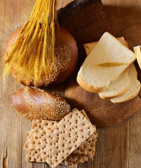 assortment of bread (rye, whole wheat, for toast)