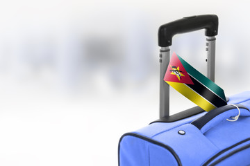 Destination Mozambique. Blue suitcase with flag.