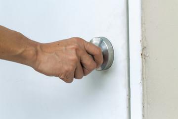 hand open door knob