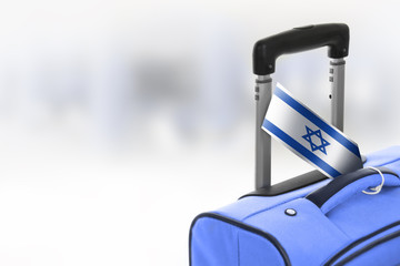 Destination Israel. Blue suitcase with flag.
