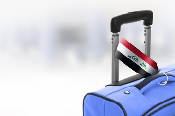 Destination Iraq. Blue suitcase with flag.