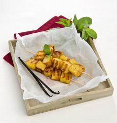 skewers of pineapple with vanilla