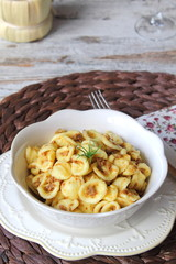Italian pasta orecchiette with sausages and onions