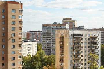 residential buildings in city block in autumn day