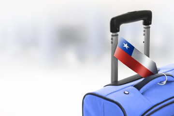 Destination Chile. Blue suitcase with flag.