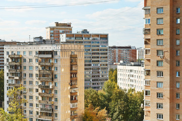 apartment houses in urban quarter in autumn day