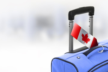 Destination Canada. Blue suitcase with flag.