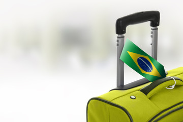 Destination Brazil. Green suitcase with flag.