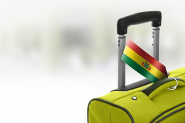 Destination Bolivia. Green suitcase with flag.