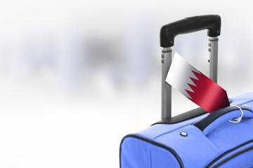 Destination Bahrain. Blue suitcase with flag.