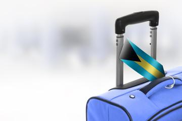Destination Bahamas. Blue suitcase with flag.