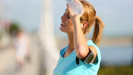 Jogger woman drinking water from bottle