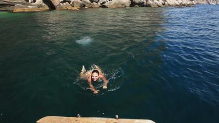 Woman exits sea