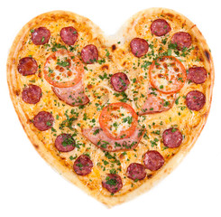 pizza in the shape of a heart with tomatoes, ham
