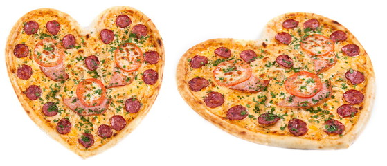 Meat pizza with ham, salami, tomatoes and cheesein heart shape