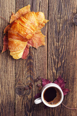 Cup coffee and croissant