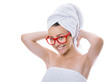 Naked girl with towel on head with healthy skin