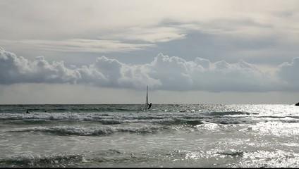 seaside ocean clouds waves and a kitesurfer