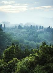 Italian house in foggy hillside