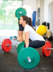 Athlete Lifting Barbell At Healthclub