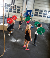 Trainers And Athletes In Weightlifting Class