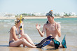 couple at sea beach with snorkel set