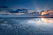canvas print picture - sunrise over North sea coast at low tide
