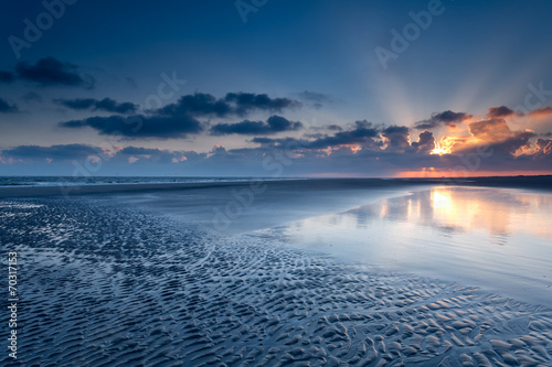 canvas print picture sunrise over North sea coast at low tide