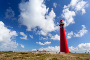 red lighthouse oer blue sky
