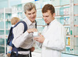 Pharmacy chemist, father and child in drugstore