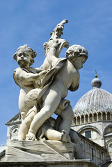 Sculptures of angels on the fountain in Pisa