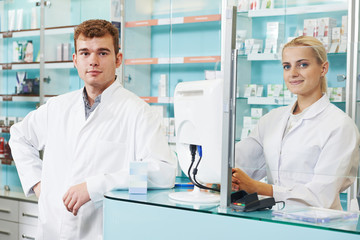 pharmaceutical workers in drugstore