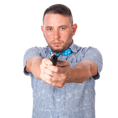 Serious adult man in summer shirt with a firearm