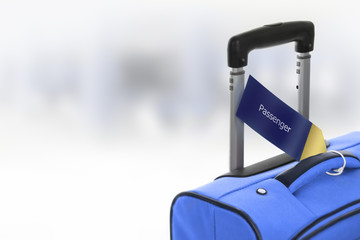 Passenger. Blue suitcase with label at airport.