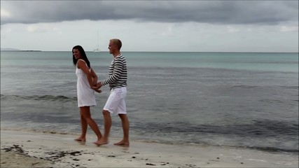 happy couple on the beach in summer