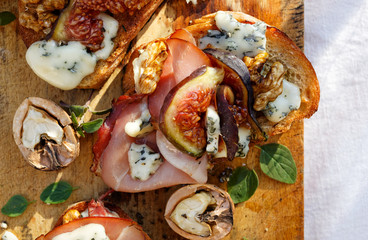 Canape with figs, blue cheese, prosciutto ham and walnuts