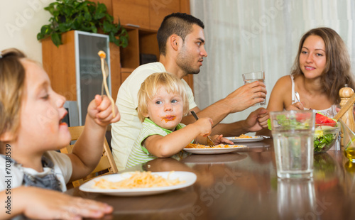 canvas print picture  family of four  having lunch with pasta