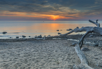 Sunset at snady beach of the Baltic Sea, Latvia, Europe