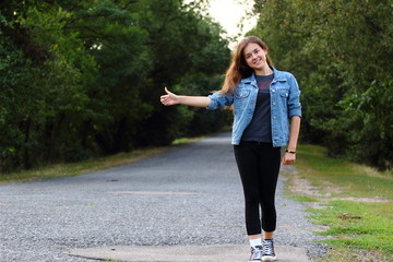 Girl on the road, hitchhiking rides