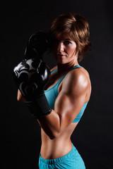 Portrait of an athletic boxer woman