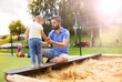 canvas print picture - Father and child on playground