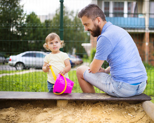Father and child on playground