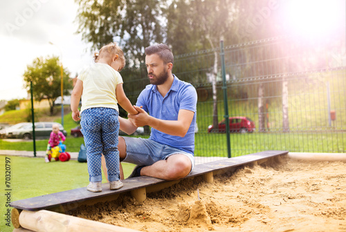 canvas print picture Father and child on playground