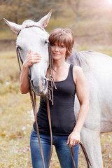 Beautiful woman with a horse