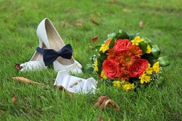 Wedding accessories, bride shoes bouquet rings bowtie