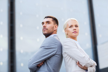 businessman and businesswoman outdoors
