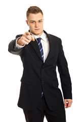 Young man in suit shows on you on isolate white background