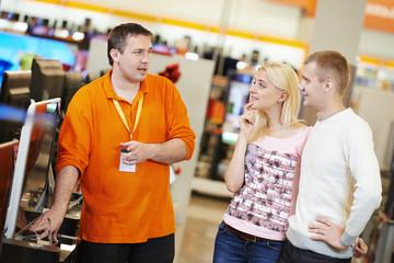family shopping at electronics supermarket